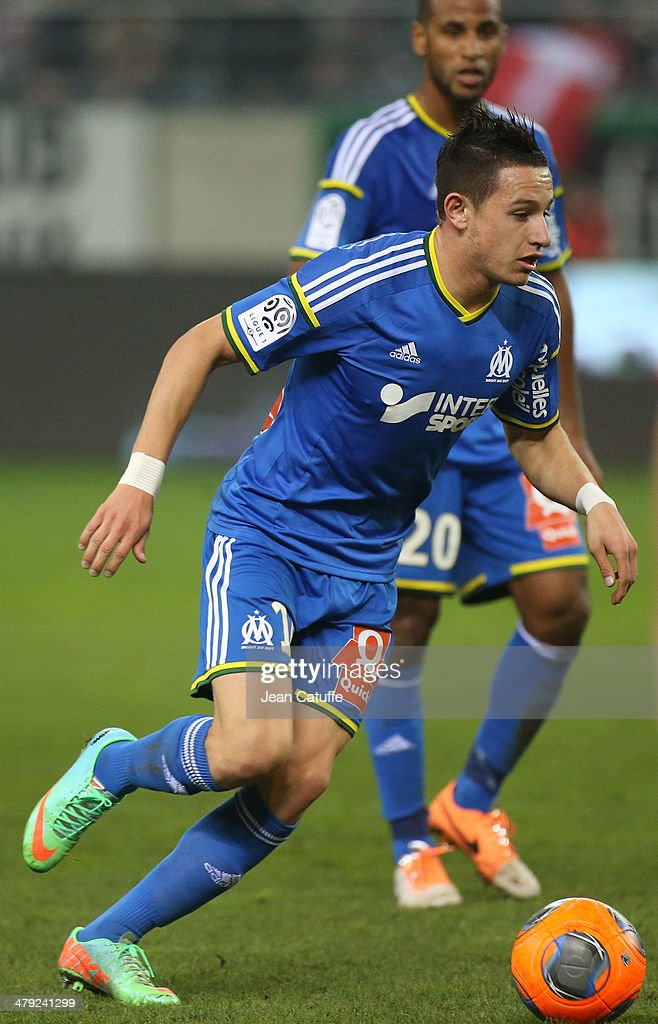 <a gi-track='captionPersonalityLinkClicked' href=/galleries/search?phrase=Florian+Thauvin&family=editorial&specificpeople=9157453 ng-click='$event.stopPropagation()'>Florian Thauvin</a> of OM in action during the french Ligue 1 match between Stade de Reims and Olympique de Marseille at the Stade Auguste Delaune stadium on March 14, 2014 in Reims, France.
