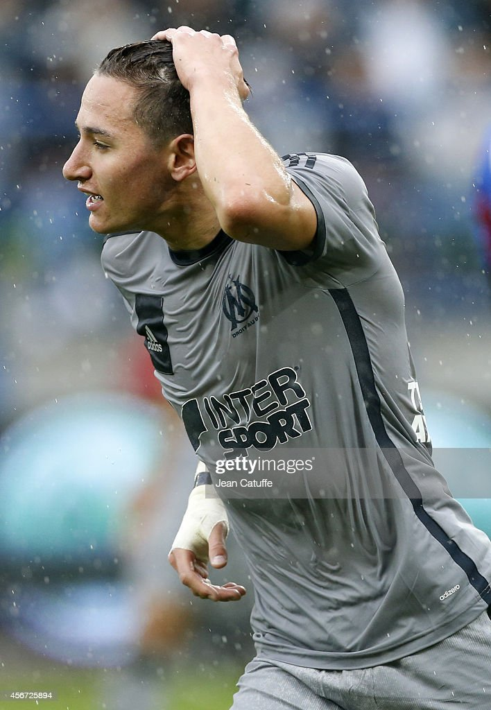 <a gi-track='captionPersonalityLinkClicked' href=/galleries/search?phrase=Florian+Thauvin&family=editorial&specificpeople=9157453 ng-click='$event.stopPropagation()'>Florian Thauvin</a> of OM reacts during the French Ligue 1 match between Stade Malherbe de Caen and Olympique de Marseille at Stade Michel D'Ornano on October 4, 2014 in Caen, France.