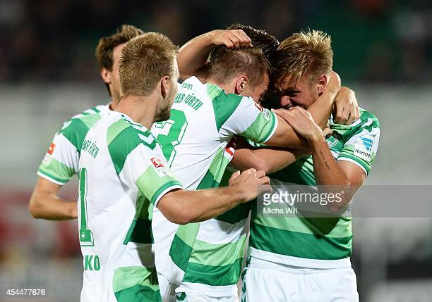 Florian Trinks of Fuerth celebrates with teammates after scoring his team's third goal during the Second Bundesliga match between Greuther Fuerth and...