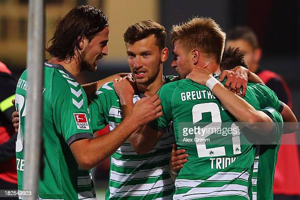 Florian Trinks of Greuther Fuerth celebrates his team's second goal with team mates during the Bundesliga match between SpVgg Greuther Fuerth and...