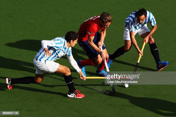 Florian Woesch of Mannheimer HC battles for the ball with Xavier Aguilar and Eduardo Arbos of Club Egara during the Euro Hockey League KO16 match...