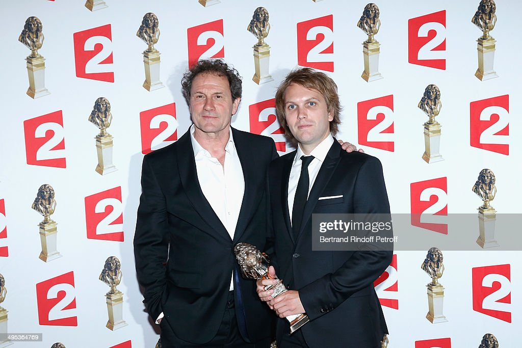 Florian Zeller (R), winner of the Moliere of Private Theatre for 'Le Pere' poses with his price after the 26th Molieres Awards Ceremony at Folies Bergere on June 2, 2014 in Paris, France.