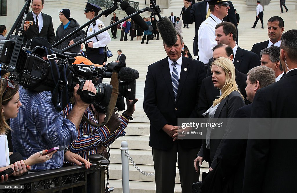 Florida Attorney General Pam Bondi (7th R) and other 25 states attorney generals who are also the plaintiffs of the lawsuit against the healthcare reform speak to the media the U.S. Supreme Court March 28, 2012 in Washington, DC. Today is the last of three day the high court set to hear arguments over the oral arguments on the Patient Protection and Affordable Care Act.