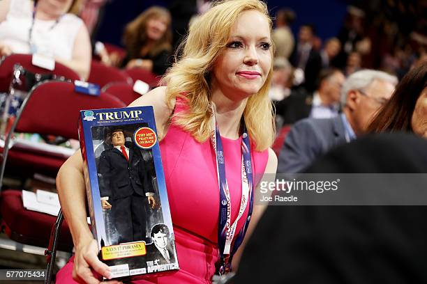 Florida delegate Dana Dougherty holds a Donald Trump doll during the first day of the Republican National Convention on July 18 2016 at the Quicken...