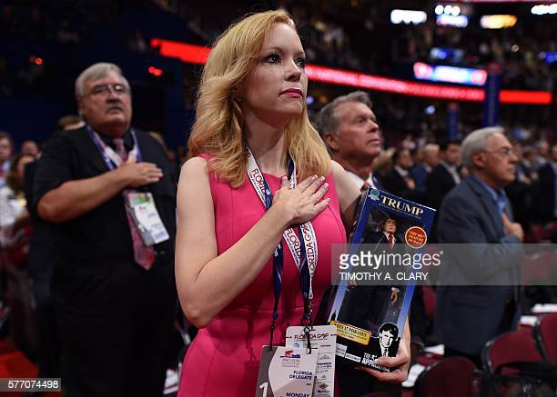 Florida delegate Dana Dougherty holds a Donald Trump doll on the first day of the Republican National Convention on July 18 2016 at the Quicken Loans...