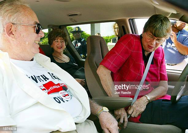 Florida Democratic gubernatorial candidate and former US Attorney General Janet Reno buckles her seatbelt as she prepares to bring supporters for...