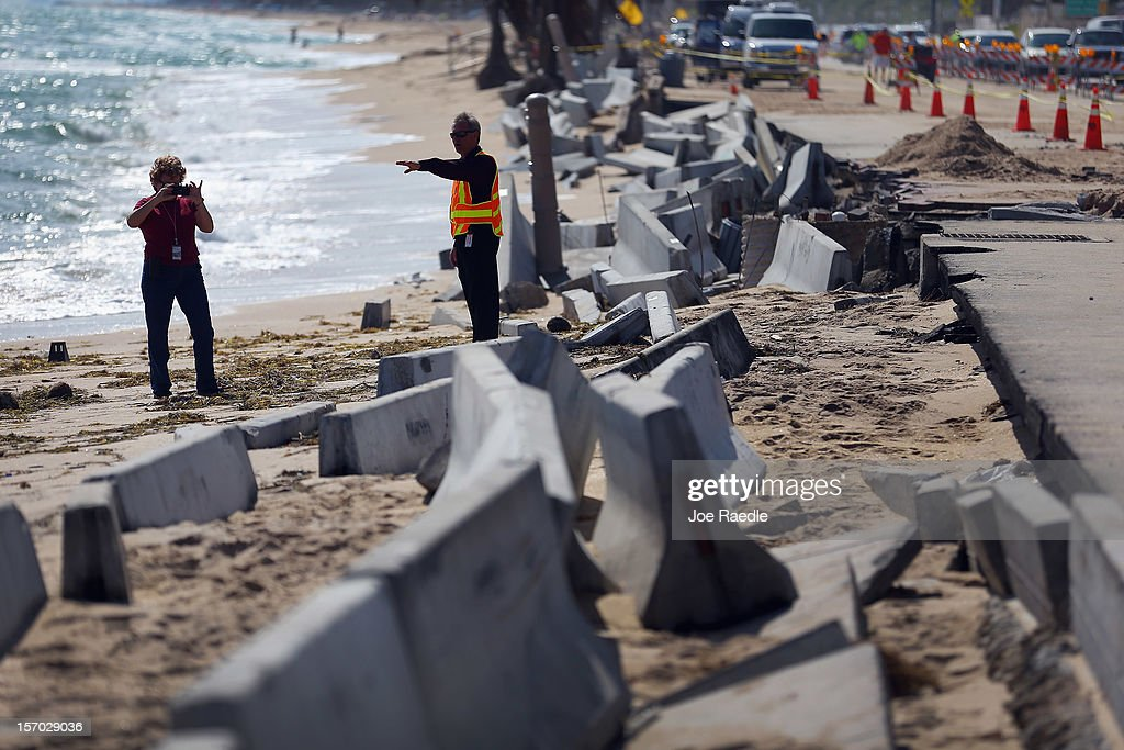 Florida Department of Transportation officials inspect the damage caused by beach erosion along route A-1-A, making parts of it impassable to vehicles on November 27, 2012 in Fort Lauderdale, Florida. The beach was eroded away last month when Hurricane Sandy passed by to the east and now City officials are saying that the damage may preview what rising sea levels can mean for coastal communities throughout South Florida. Climate scientists predict sea levels in South Florida will rise by 1 foot by 2070, 2 feet by 2115, and 3 feet by 2150.