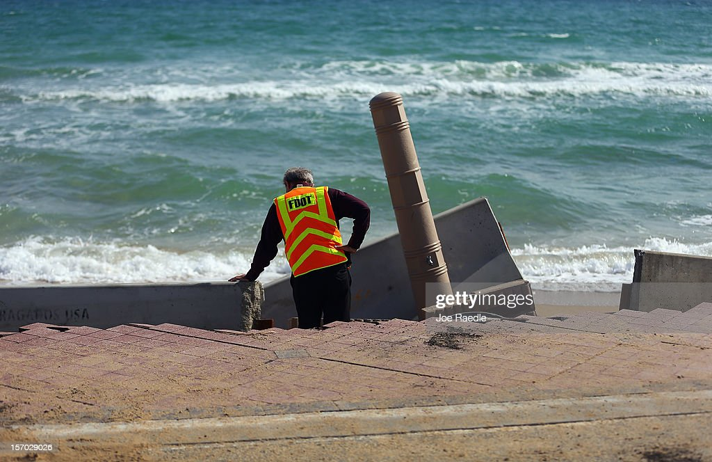 Florida Department of Transportation Operations Engineer, Cleo Marsh, inspects the damage done to route A-1-A by the ocean, making parts of it impassable to vehicles on November 27, 2012 in Fort Lauderdale, Florida. The beach was eroded away last month when Hurricane Sandy passed by to the east and now City officials are saying that the damage may preview what rising sea levels can mean for coastal communities throughout South Florida. Climate scientists predict sea levels in South Florida will rise by 1 foot by 2070, 2 feet by 2115, and 3 feet by 2150.