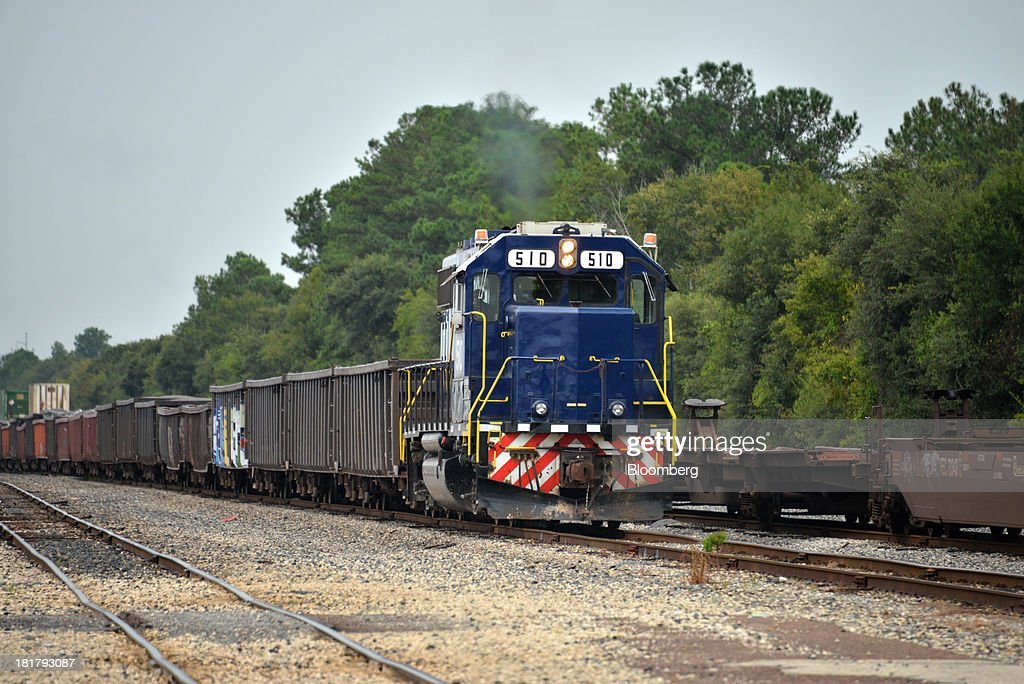A Florida East Coast Railway (FEC) locomotive navigates a rock unit train through the railway's Bowden Yard in Jacksonville, Florida, U.S., on Monday Sept. 23, 2013. The FEC is a 351-mile freight rail system along the east coast of Florida, connecting the ports of Miami, Fort Lauderdale and Palm Beach, which transports intermodal shipments, provides carload service and moves commodities, automobiles, bulk liquids, building materials, orange juice and electronics. Photographer: Mark Elias/Bloomberg via Getty Images