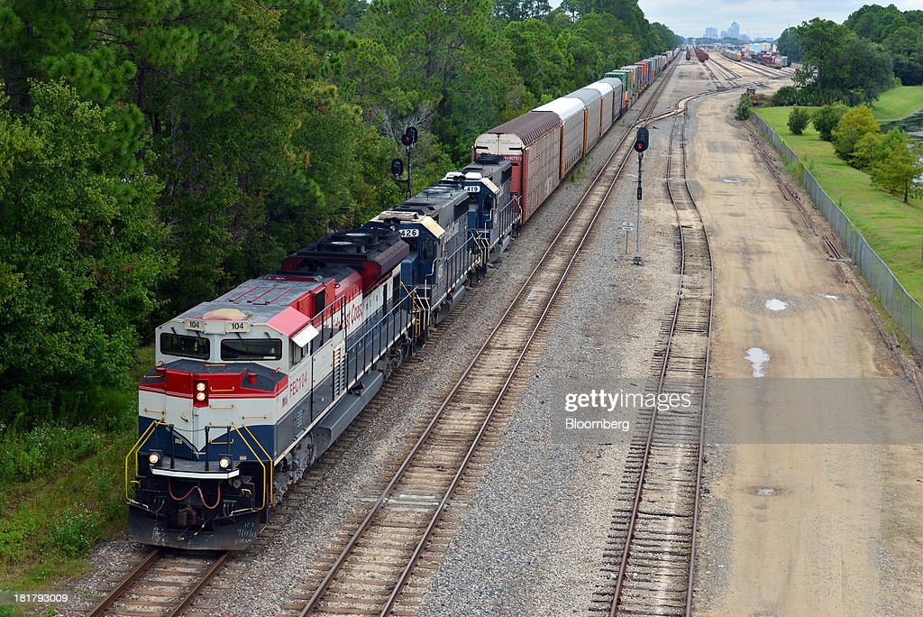 A Florida East Coast Railway (FEC) train departs from the railway's Bowden Yard in Jacksonville, Florida, U.S., on Monday Sept. 23, 2013. The FEC is a 351-mile freight rail system along the east coast of Florida, connecting the ports of Miami, Fort Lauderdale and Palm Beach, which transports intermodal shipments, provides carload service and moves commodities, automobiles, bulk liquids, building materials, orange juice and electronics. Photographer: Mark Elias/Bloomberg via Getty Images