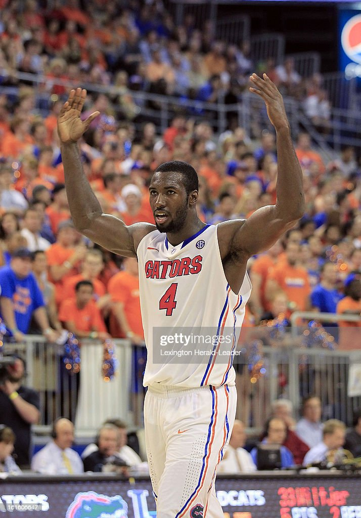 Florida Gators center Patric Young (4) encourages the crowd after a Florida run against Kentucky at the O'Connell Center in Gainesville, Florida, Tuesday, February 12, 2013. Florida defeated UK
