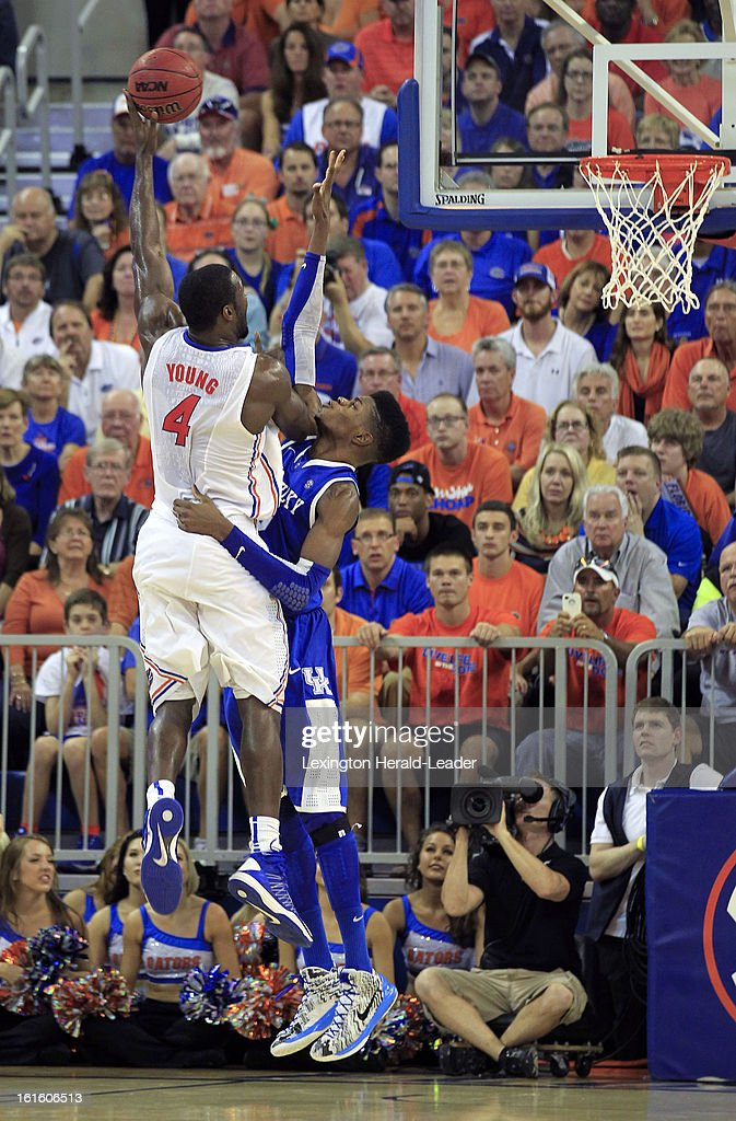 Florida Gators center Patric Young (4) scores over Kentucky Wildcats forward Nerlens Noel (3) in the second half at the O'Connell Center in Gainesville, Florida, Tuesday, February 12, 2013. Florida defeated UK