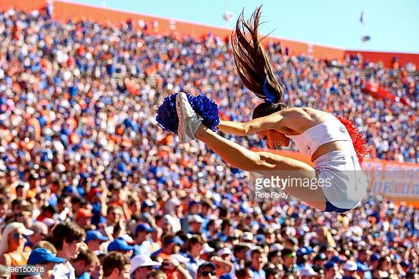 Florida Gators cheerleader is tossed in the air during the second half of the game against the Vanderbilt Commodores at Ben Hill Griffin Stadium on...