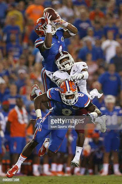 Florida Gators defensive back Vernon Hargreaves III intercepts a pass over New Mexico State wide receiver Tyrain Taylor and Florida Gators defensive...