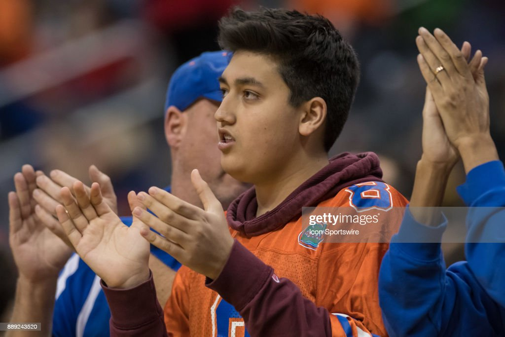 Florida Gators fans cheer during the second half of the Never Forget Tribute Classic college basketball game between the Cincinnati Bearcats and the Florida Gators on December 9, 2017, at the Prudential Center in Newark, NJ.