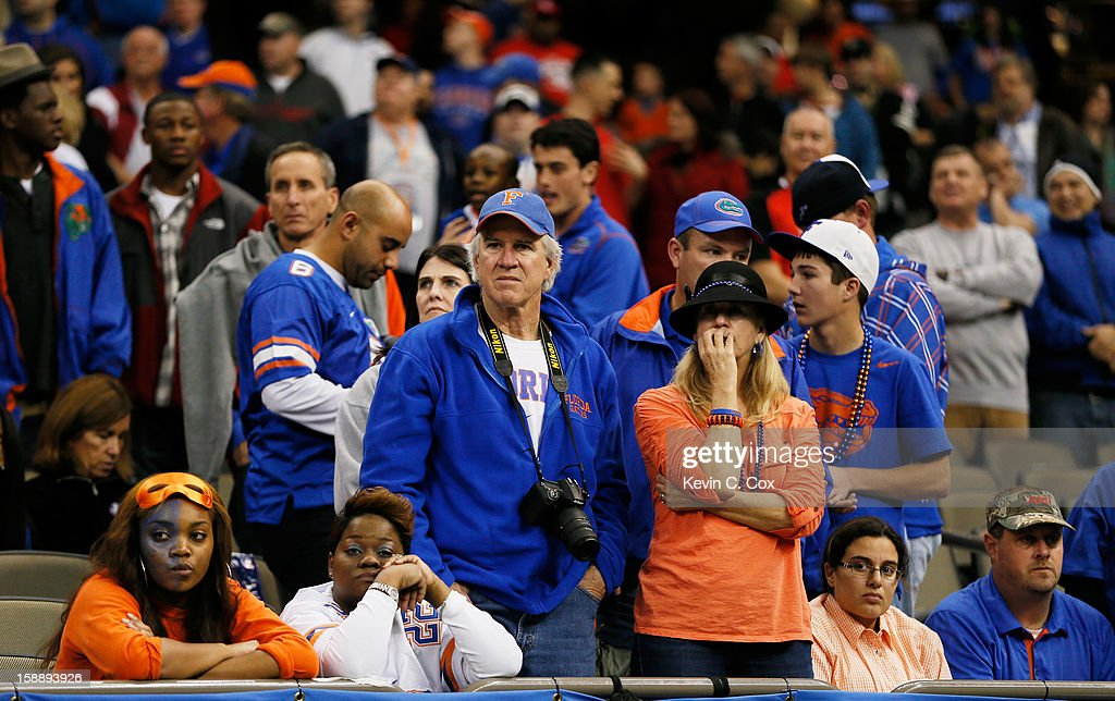 Florida Gators fans react during their 33 to 23 loss to the Louisville Cardinals during the Allstate Sugar Bowl at Mercedes-Benz Superdome on January 2, 2013 in New Orleans, Louisiana.