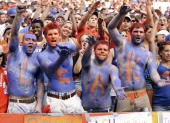 Florida Gators fans shoow their support for quarterback Chris Leak during their team's game against the Louisiana State Tigers at Ben Hill Griffin...