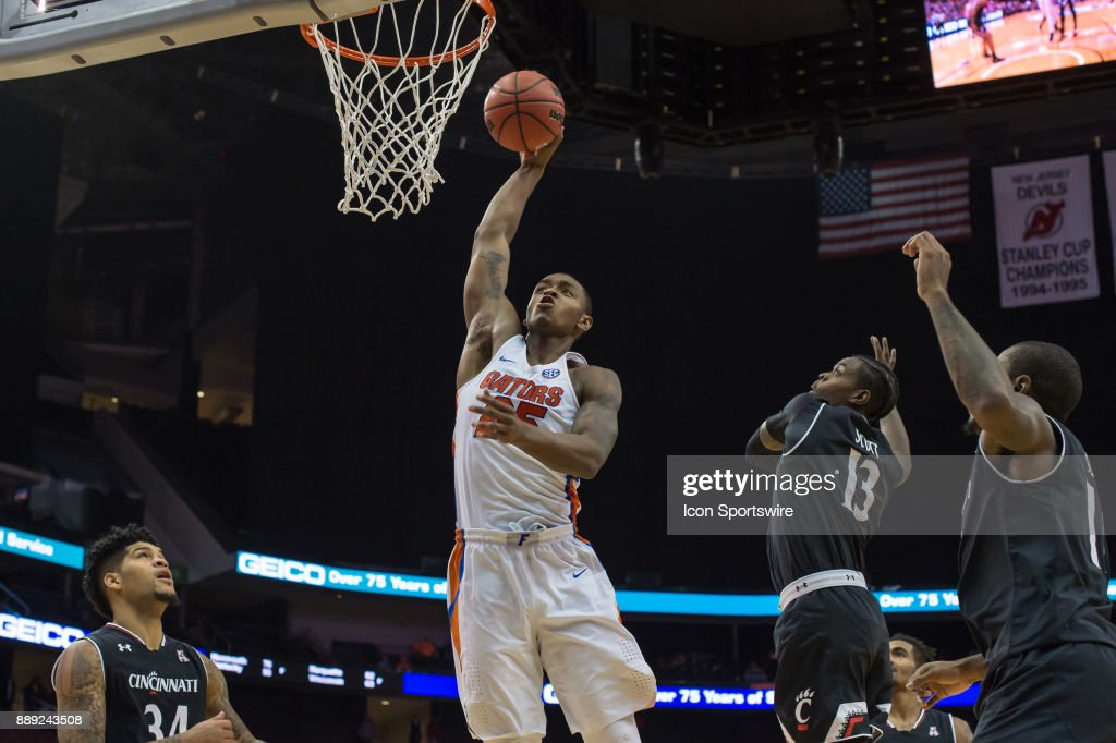 Florida Gators forward Keith Stone (25) soars for a huge missed dunk during the second half of the Never Forget Tribute Classic college basketball game between the Cincinnati Bearcats and the Florida Gators on December 9, 2017, at the Prudential Center in Newark, NJ.