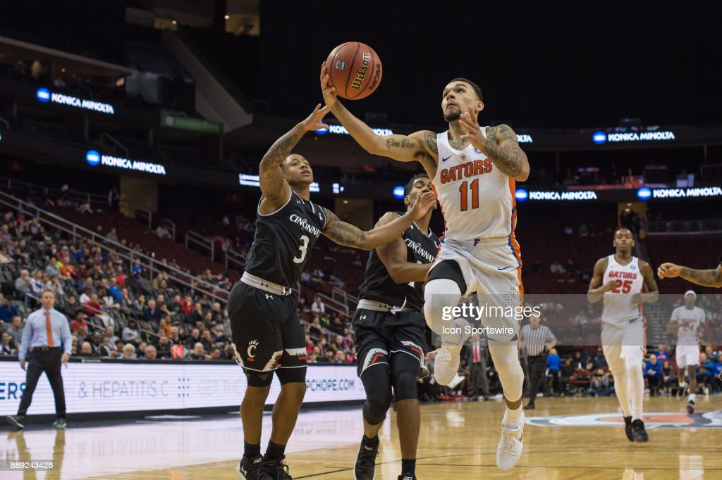 Florida Gators guard Chris Chiozza (11) drives to the basket during the second half of the Never Forget Tribute Classic college basketball game between the Cincinnati Bearcats and the Florida Gators on December 9, 2017, at the Prudential Center in Newark, NJ.