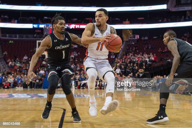 Florida Gators guard Chris Chiozza drives to the basket during the second half of the Never Forget Tribute Classic college basketball game between...