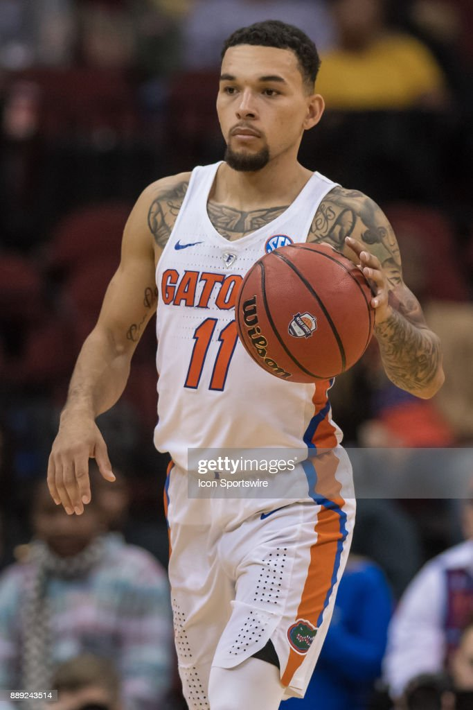 Florida Gators guard Chris Chiozza (11) during the second half of the Never Forget Tribute Classic college basketball game between the Cincinnati Bearcats and the Florida Gators on December 9, 2017, at the Prudential Center in Newark, NJ.