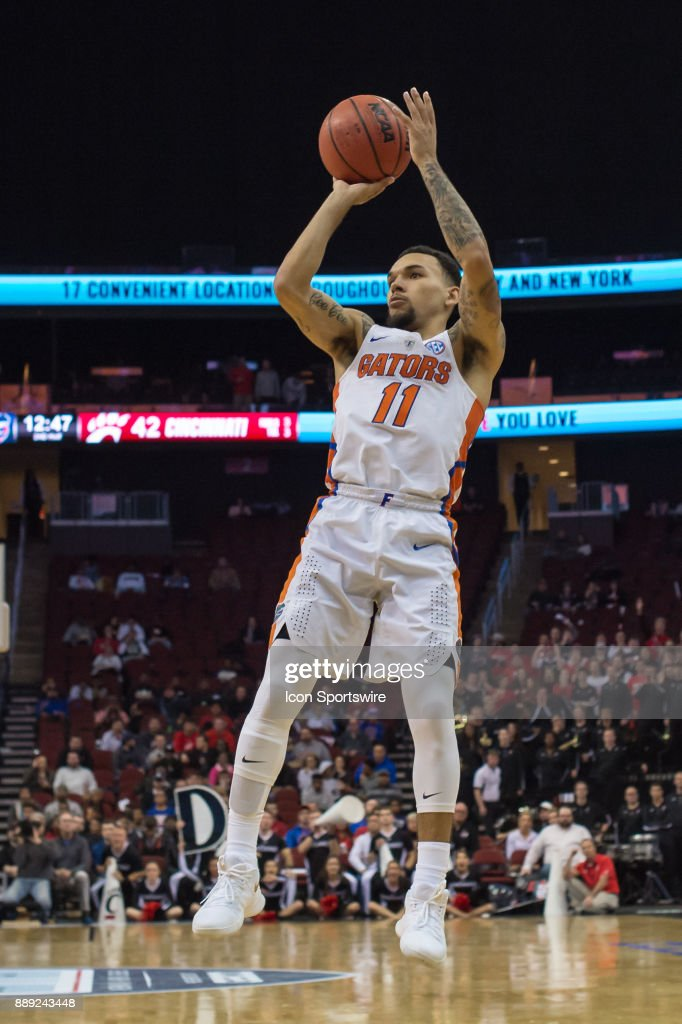 Florida Gators guard Chris Chiozza (11) shoots the ball during the second half of the Never Forget Tribute Classic college basketball game between the Cincinnati Bearcats and the Florida Gators on December 9, 2017, at the Prudential Center in Newark, NJ.