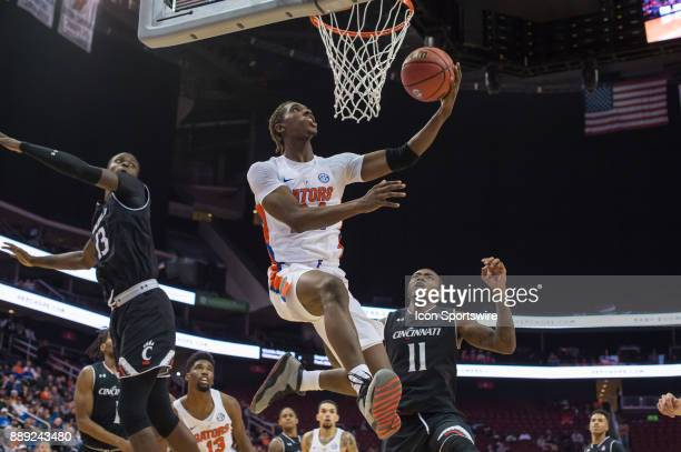 Florida Gators guard Deaundrae Ballard drives to the basket during the second half of the Never Forget Tribute Classic college basketball game...