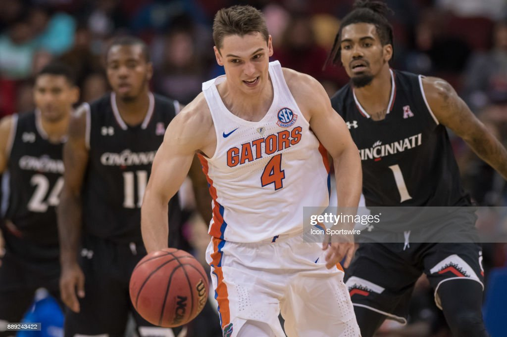 Florida Gators guard Egor Koulechov (4) chases a loose ball during the first half of the Never Forget Tribute Classic college basketball game between the Cincinnati Bearcats and the Florida Gators on December 9, 2017, at the Prudential Center in Newark, NJ.