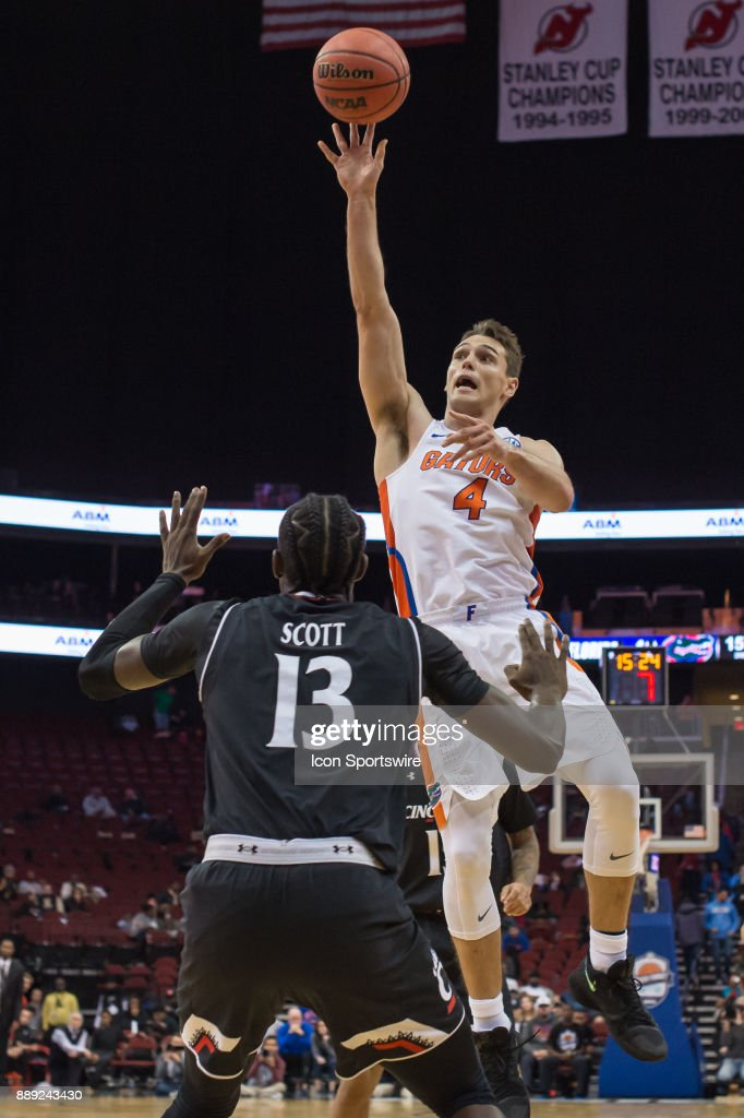 Florida Gators guard Egor Koulechov (4) drives to the basket during the second half of the Never Forget Tribute Classic college basketball game between the Cincinnati Bearcats and the Florida Gators on December 9, 2017, at the Prudential Center in Newark, NJ.