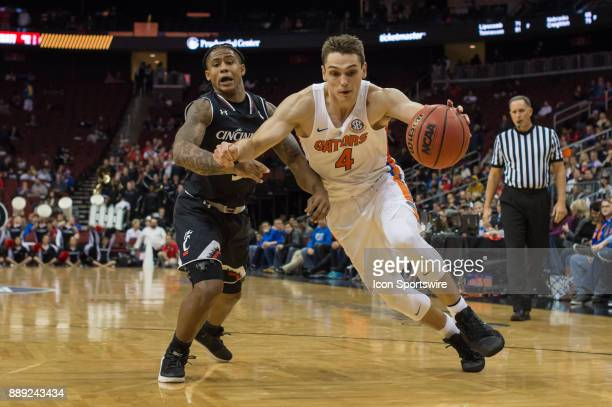 Florida Gators guard Egor Koulechov drives to the basket during the second half of the Never Forget Tribute Classic college basketball game between...