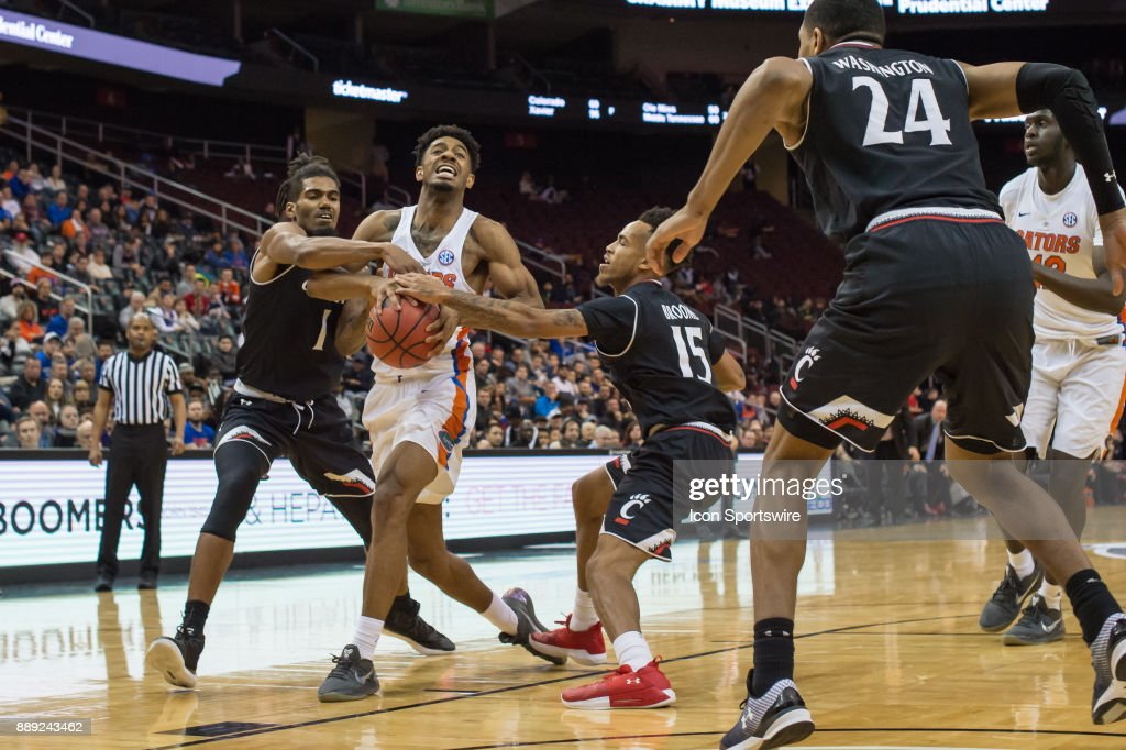 Florida Gators guard Jalen Hudson (3) is fouled during the second half of the Never Forget Tribute Classic college basketball game between the Cincinnati Bearcats and the Florida Gators on December 9, 2017, at the Prudential Center in Newark, NJ.