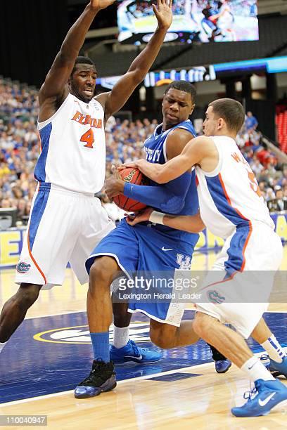 Florida Gators guard Scottie Wilbekin and Florida Gators forward/center Patric Young tie up Kentucky Wildcats forward Terrence Jones during the...
