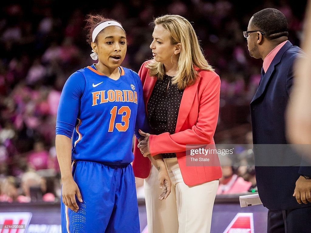Florida Gators head coach Amanda Butler speaks with guard Cassie Peoples (13) during the first half of a women's college basketball game against the South Carolina Gamecocks at Colonial Life Arena in Columbia, S.C., on Sunday, Feb. 23, 2014.