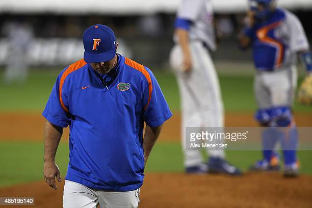 Florida Gators head coach Kevin O'Sullivan walks back to the dugout after changing pitchers during an NCAA baseball game against the UCF Knights at...