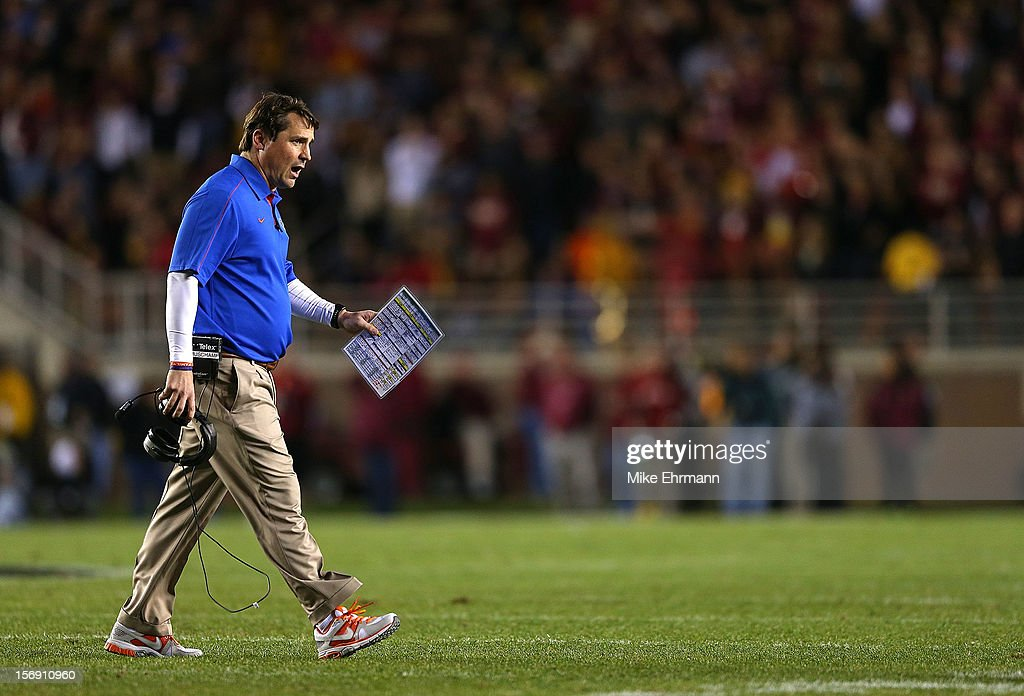 Florida Gators head coach <a gi-track='captionPersonalityLinkClicked' href=/galleries/search?phrase=Will+Muschamp&family=editorial&specificpeople=2248036 ng-click='$event.stopPropagation()'>Will Muschamp</a> looks on during a game against the Florida State Seminoles at Doak Campbell Stadium on November 24, 2012 in Tallahassee, Florida.