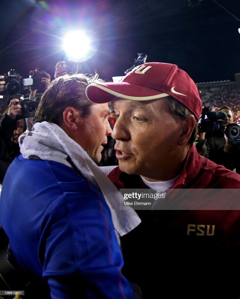 Florida Gators head coach Will Muschamp shakes hands with Florida State Seminoles head coach Jimbo Fisher following a game at Doak Campbell Stadium on November 24, 2012 in Tallahassee, Florida.