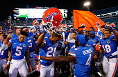 Florida Gators players celebrate following a 3820 victory over the Georgia Bulldogs at EverBank Field on November 1 2014 in Jacksonville Florida