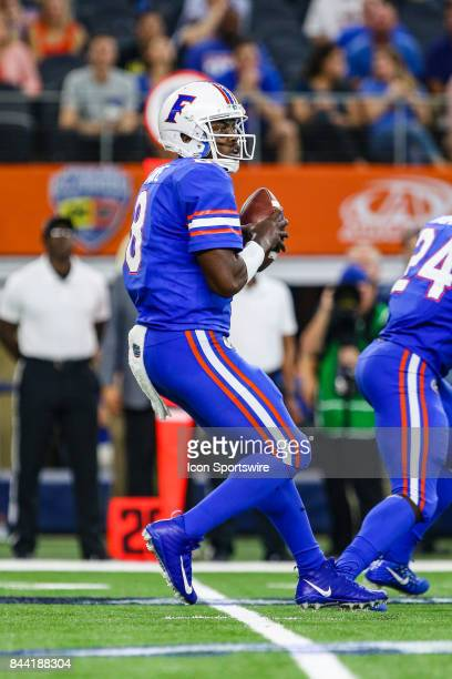 Florida Gators quarterback Malik Zaire looks downfield for an open receiver during the game between the Michigan Wolverines and the Florida Gators on...