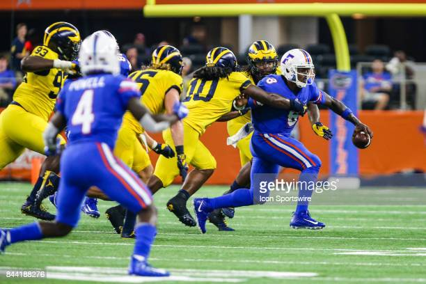 Florida Gators quarterback Malik Zaire tries to escape form Michigan Wolverines linebacker Devin Bush during the game between the Michigan Wolverines...