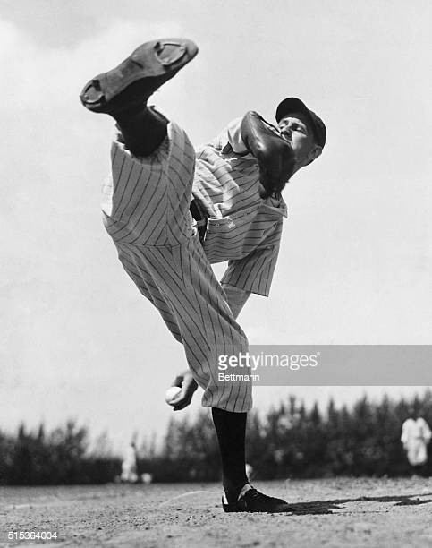 Gomez Tosses Them In This unusual picture shows Lefty Gomez one of the New York Yankees pitching aces as he prepared to steam one across the plate in...
