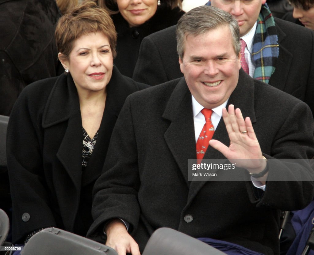Florida Gov. Jeb Bush and his wife Columba wave to the crowd as they are seated on the inaugural stage January 20, 2005 in Washington, D.C. U.S. President George W. Bush will be sworn in for a second term during the inaugural ceremony.