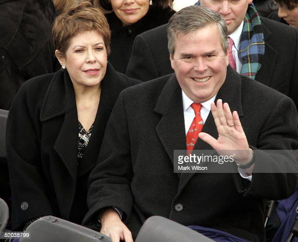 Florida Gov Jeb Bush and his wife Columba wave to the crowd as they are seated on the inaugural stage January 20 2005 in Washington DC US President...