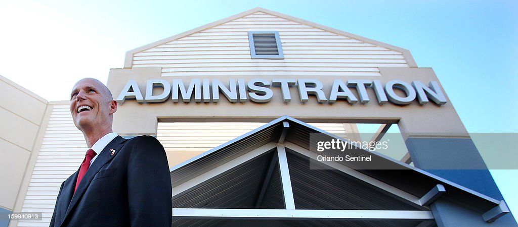 Florida Gov. Rick Scott arrives for the announcement of his proposal to raise teacher pay statewide in the upcoming state budget, during a news conference at a middle school in Ocoee, Florida, on Wednesday, January 23, 2013.