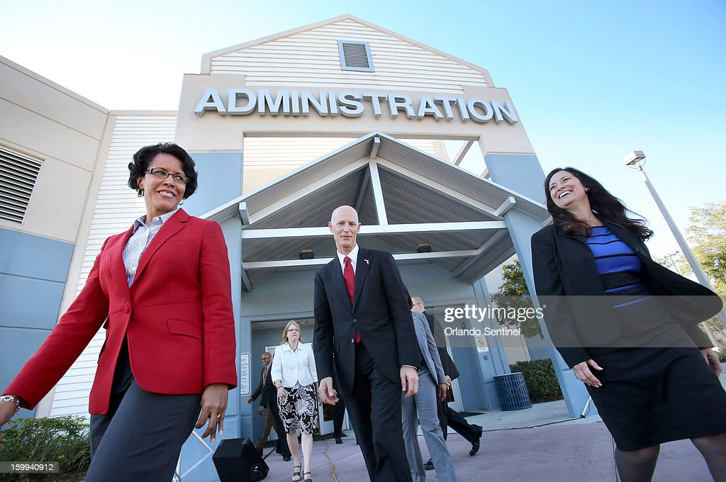 Florida Gov. Rick Scott is joined by Orange County schools superintendent Barbara Jenkins, left, and Ocoee Middle School principal Sharyn Gabriel, as they arrive for the announcement of the governor's proposal to raise teacher pay statewide in the upcoming state budget, during a news conference at the school in Ocoee, Florida, on Wednesday, January 23, 2013.