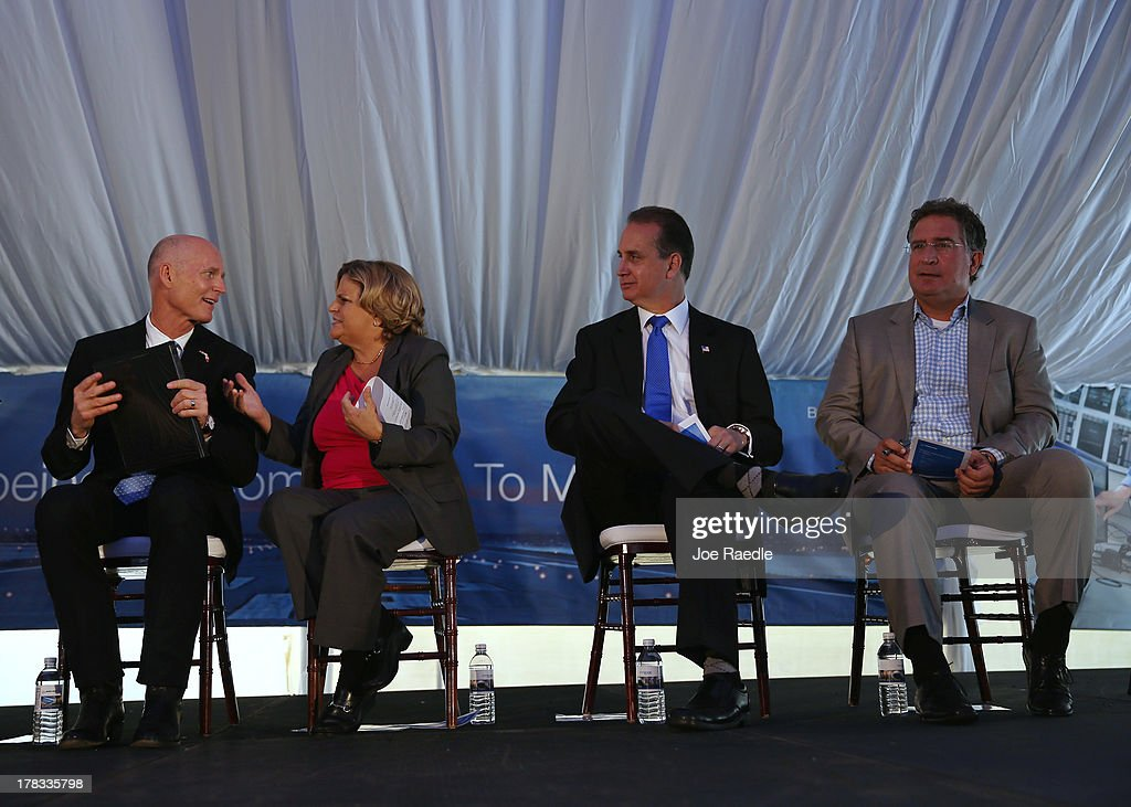 Florida Gov. Rick Scott (L) sits with Rep. Ileana Ros-Lehtinen (R-FL), Rep. Mario Diaz-Balart (R-FL) and Rep. Joe Garcia (D-FL) at the grand opening of the main North American training campus for Boeing that includes full-flight simulators for the 787 Dreamliner on August 29, 2013 in Miami, Florida. Boeing officials say the Miami campus will be one of the largest airline training centers in the world.