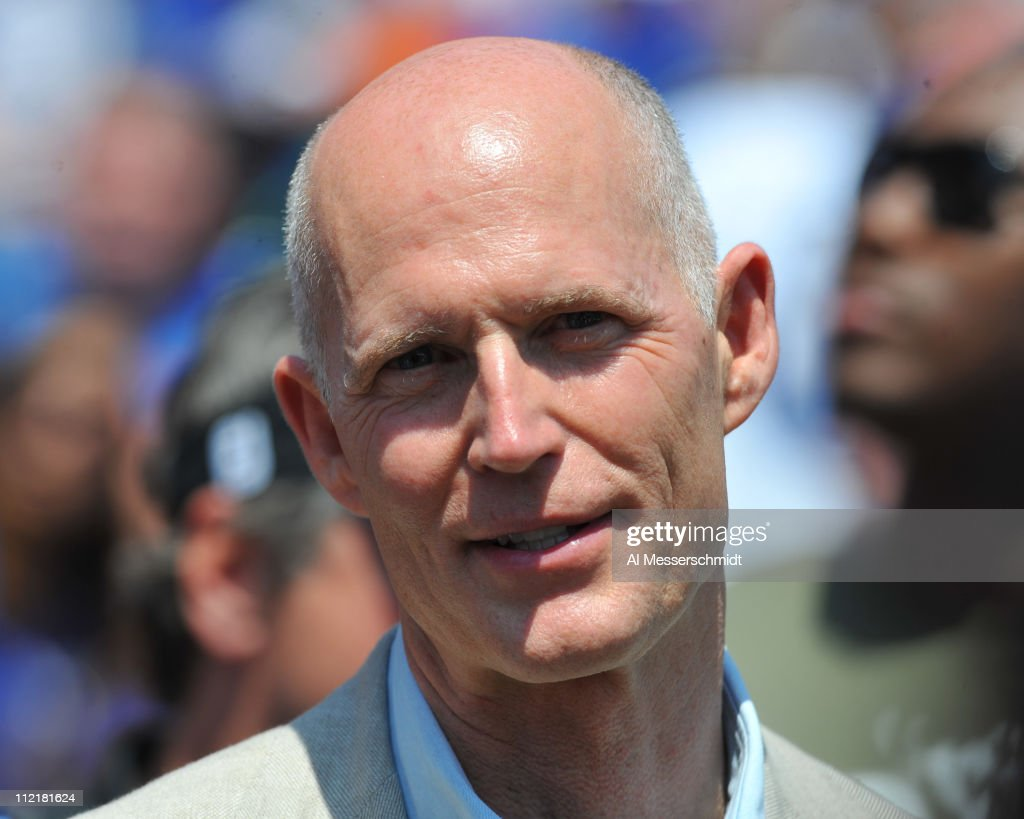 Florida Gov. Rick Scott watches the Florida Gators Orange and Blue spring football game from the sidelines April 9, 2011 at Ben Hill Griffin Stadium in Gainesville, Florida.