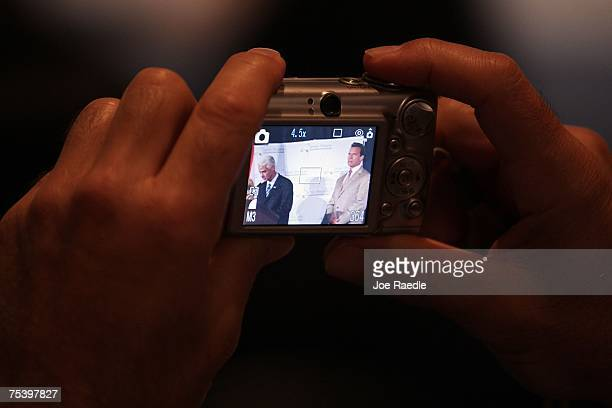 Florida Governor Charlie Crist and California Governor Arnold Schwarzenegger are seen on the display of a camera during a signing ceremony of...