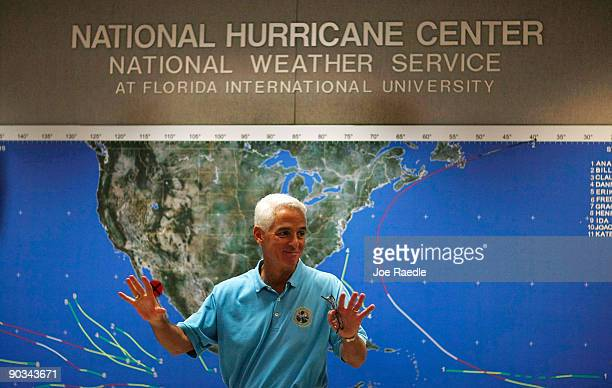 Florida Governor Charlie Crist stands in front of a hurricane tracking map during a visit to the National Oceanic and Atmospheric Administration...