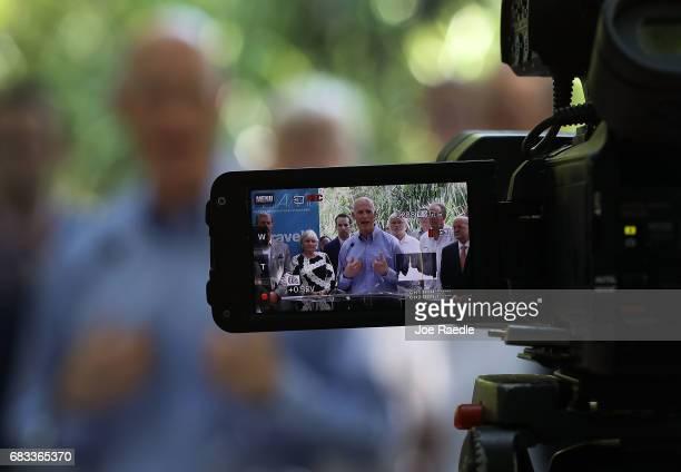 Florida Governor Rick Scott announces during a press conference at Jungle Island that the number of tourists visiting the state for the first three...