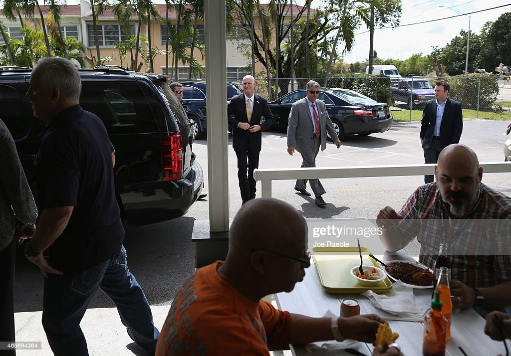 Florida Governor <a gi-track='captionPersonalityLinkClicked' href=/galleries/search?phrase=Rick+Scott+-+Pol%C3%ADtico&family=editorial&specificpeople=2370892 ng-click='$event.stopPropagation()'>Rick Scott</a> (C) arrives for a road expansion event at the Casa Maiz restaurant where he fielded questions from reporters about climate change on March 9, 2015 in Hialeah, Florida. Recent reports indicate that the Florida governor allegedly issued orders for certain state agencies to not to use the term 'climate change' or 'global warming' in any official communications, emails, or reports.